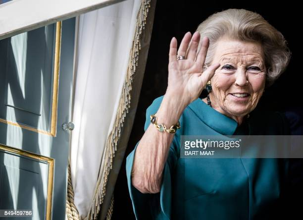TOPSHOT Dutch Princess Beatrix waves from the Carriage of the King during the 'Prinsjesdag' in The Hague on September 19 2017 Prince's Day is the...