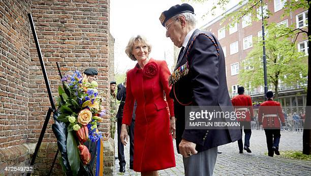 Dutch Princess Irene and a war veteran lay flowers during the parade of Guards Regiment Fusiliers in The Hague on May 8 2015 The parade is to...