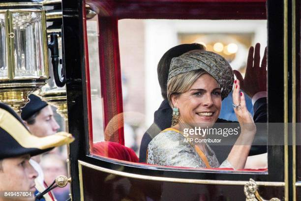 Dutch Princess Laurentien waves from a Carriage during the 'Prinsjesdag' at the Binnenhof in The Hague on September 19 2017 Prince's Day is the...