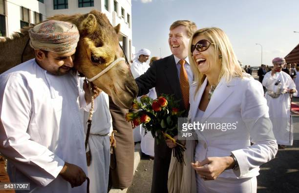 Dutch princess Maxima and Crown Prince Willem Alexander laugh as they stand next to a camel in Sohar on January 16 2009 Crown Prince Willem Alexander...