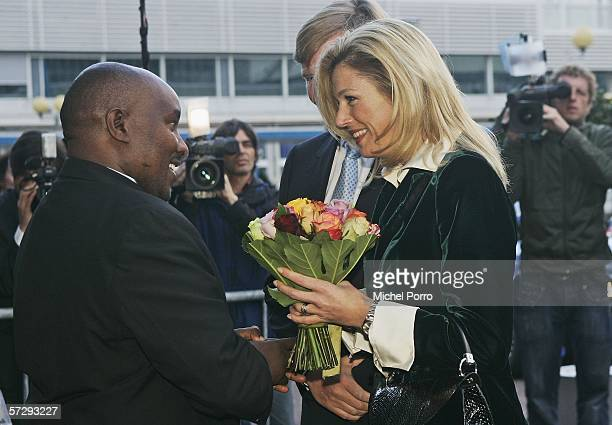 Dutch Princess Maxima and Dutch Crown Prince Willem Alexander are welcomed by John Muiruri before they attend the Black Pinochio Theatre on April 9...