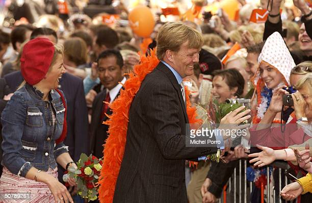 Dutch Princess Maxima and Dutch Crown Prince Willem Alexander greet the public during birthday celebrations for Queen Beatrix April 30 2004 in...