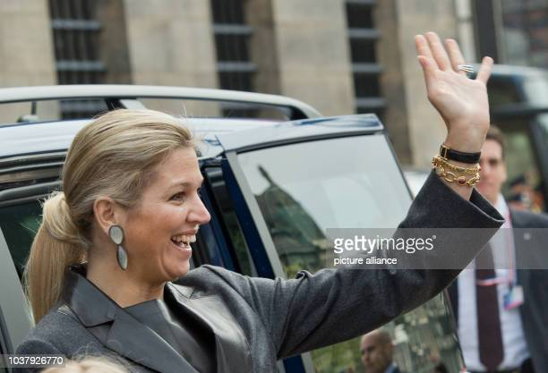 Dutch Princess Maxima cheers the crowd as she arrives for a rehearsal for the upcoming investiture of the country's new King at the Royal Palace in...