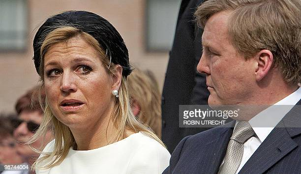 Dutch Princess Maxima cries next Dutch Prince Willem-Alexander as they attend on April 29, 2010 in Apeldoorn a ceremony at the monument of remebrance...
