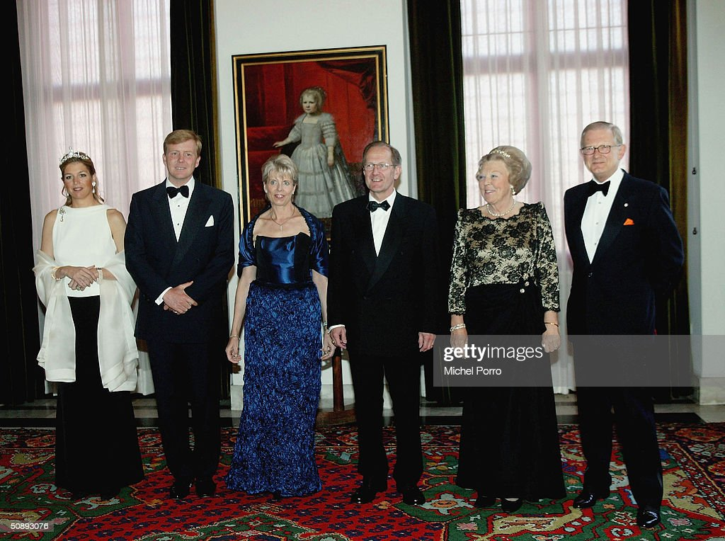 Dutch Princess Maxima, Crown Prince Willem Alexander, President Joseph Deiss with his wife, Dutch Queen Beatrix and Pieter van Vollenhoven smile during a group photo with visiting Swiss President Deiss May 24, 2004 in Amsterdam, The Netherlands.