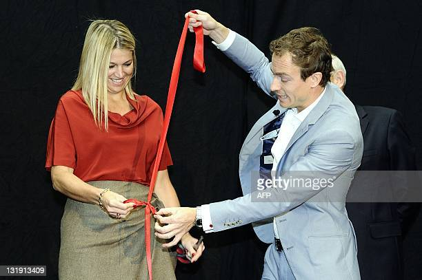 Dutch Princess Maxima helps illusionist Jan Reinder Kammen on November 8 2011 during the opening conference of the European Office of The...