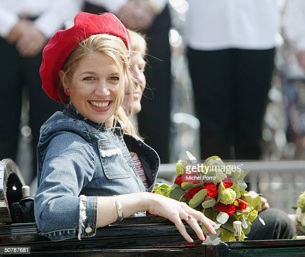 Dutch Princess Maxima sitting next to Dutch Crown Prince Willem Alexander smiles during birthday celebrations for Queen Beatrix April 30 2004 in...