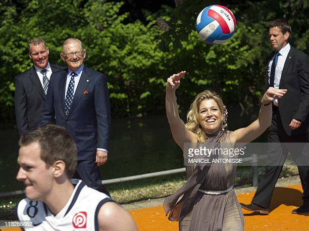 Dutch Princess Maxima throws a volleyball during the Queensday celebration in Weert on April 30 2011 AFP PHOTO/ANP/ROYAL IMAGES/MARCEL ANTONISSE...
