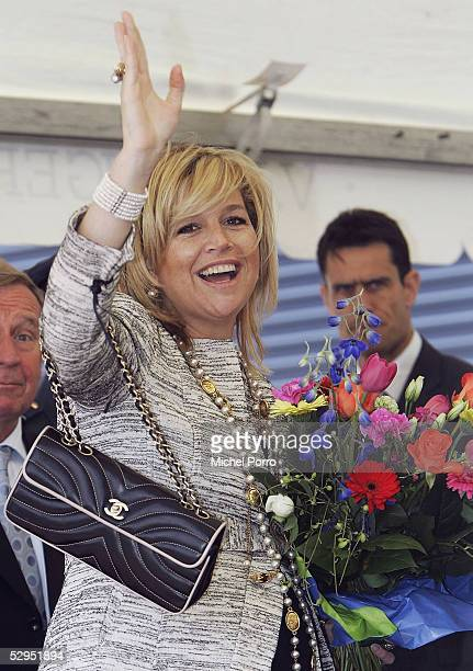 Dutch Princess Maxima waves at the King Willem I College while attending a ceremony in which the school received a No Racism Certificate on May 19,...