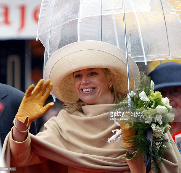 """Dutch Princess Maxima waves during """"Queen's Day"""" celebrations April 30, 2002 in Meppel, The Netherlands. Traditionally, Queen Beatrix celebrates her..."""