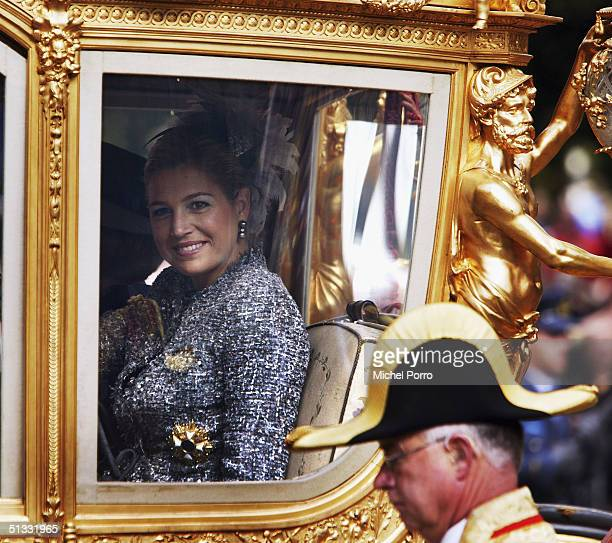 Dutch Princess Maxima waves from what is publically known as the Golden Carriage during the traditional ceremony to mark the annual opening of...