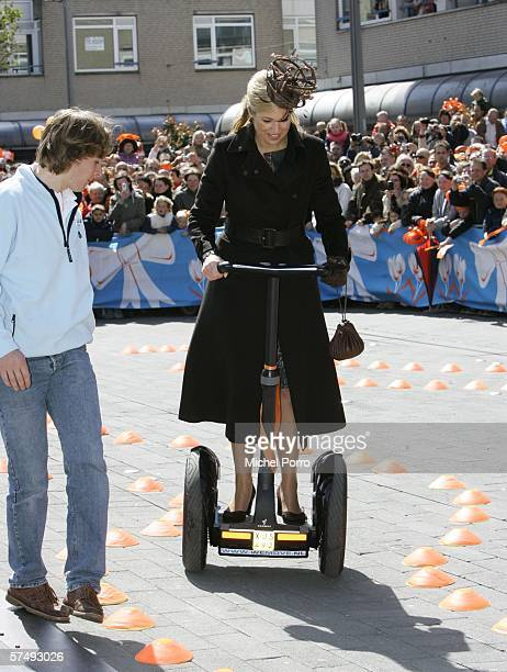 Dutch Princess Maxima wheels around on a batterypowered 'electronic pedestrian' called Segway during the traditional Queens Day celebratons on April...