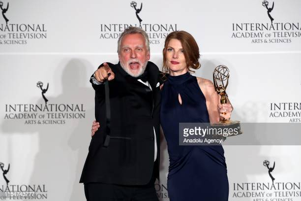 Dutch producer Femke Wolting and director Hans Pool pose in the press room with the award for Documentary for Bellingcat Truth in the a PostTruth...