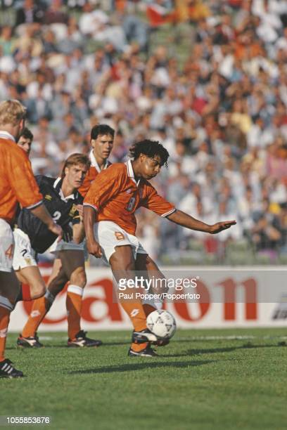 Dutch professional footballer Frank Rijkaard midfielder with AC Milan pictured in action striking the ball for the Netherlands national team in the...