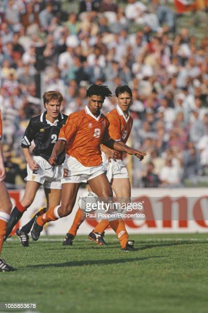 Dutch professional footballer Frank Rijkaard midfielder with AC Milan pictured with support from Marco van Basten behind in action playing for the...