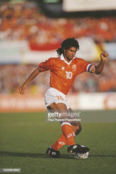 Dutch professional footballer Ruud Gullit midfielder/forward with AC Milan pictured in action with the ball for the Netherlands team during play in...