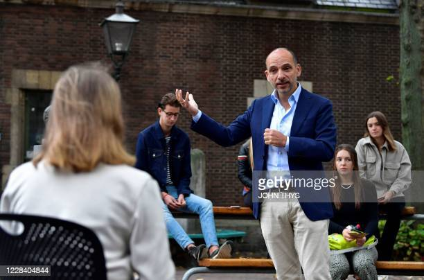 Dutch Professor Edward Nieuwenhuis of Roosevelt College University gives an introduction live science to 25 students outside, on a square in the...