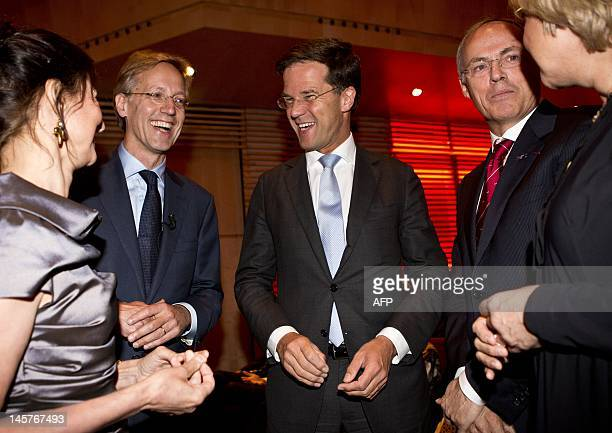 Dutch professor of Mathematical Physics Robbert Dijkgraaf and his wife talks with his successor Hans Clevers and his wife and Dutch Prime Minister...