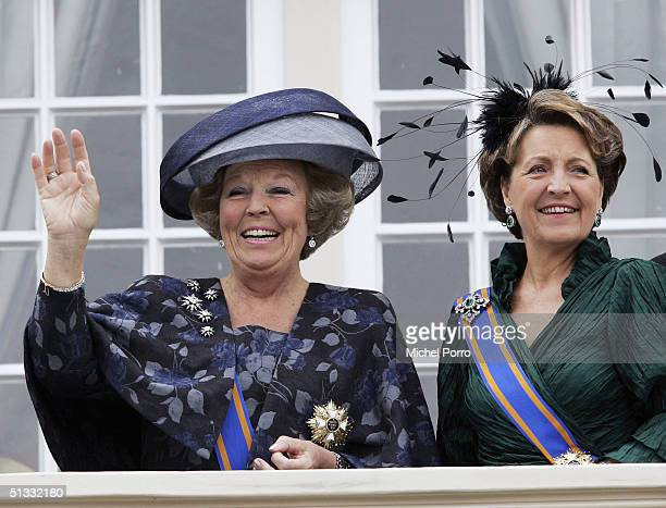 Dutch Queen Beatrix and her sister Princess Margriet wave from the balcony of the Noordeinde Palace during the traditional ceremony to mark the...