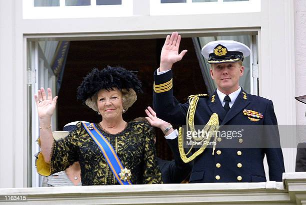 Dutch Queen Beatrix and her son Crown Prince Willem Alexander wave after the presentation to the cabinet of the budget for 2002, September 18, 2001...