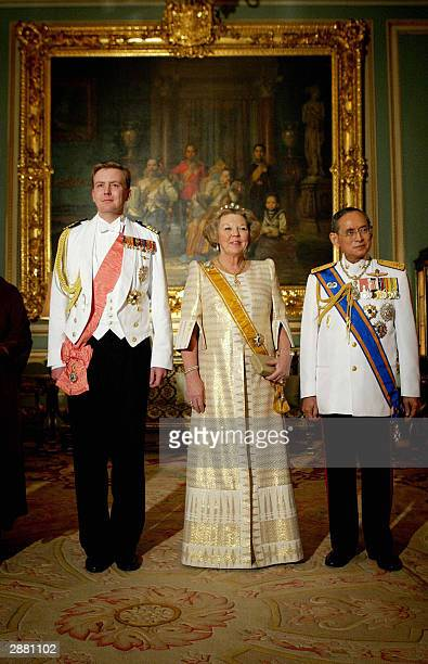 Dutch Queen Beatrix and her son Prince Willem Alexander pose with Thai King Bhumibol Adulyadej at the royal palace in Bangkok 19 January 2004 during...
