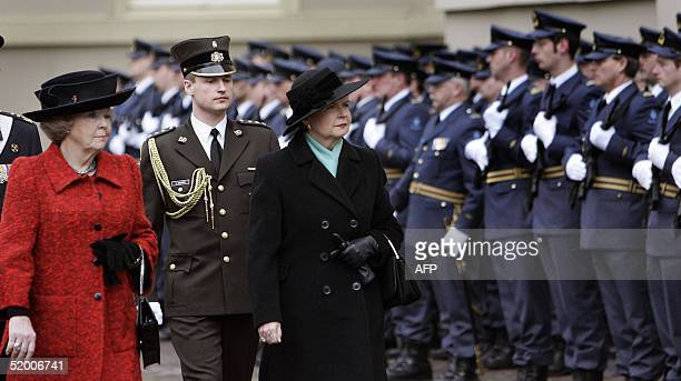 Dutch Queen Beatrix and Latvian President Vaira VikeFreiberga inspecting the honour guard at the Noordeinde Palace in The Hague on Freiberga's...