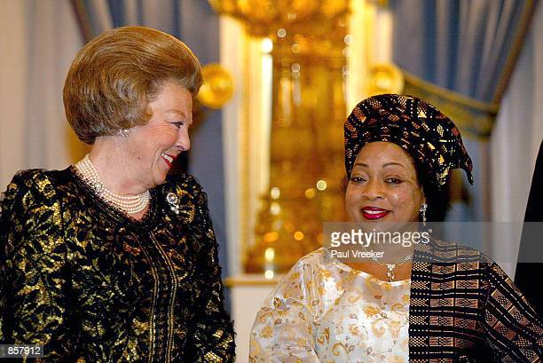 Dutch Queen Beatrix and Stella Obasanjo the wife of Nigerian President Olusegun Obasanjo attend a state banquet March 13 2002 at The Hague The...