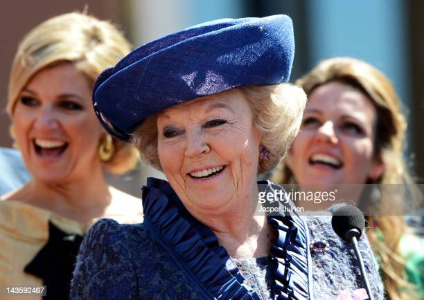 Dutch Queen Beatrix of the Netherlands smiles during the traditional Queens Day celebrations on April 30, 2012 in Rhenen, Netherlands. Parties and...