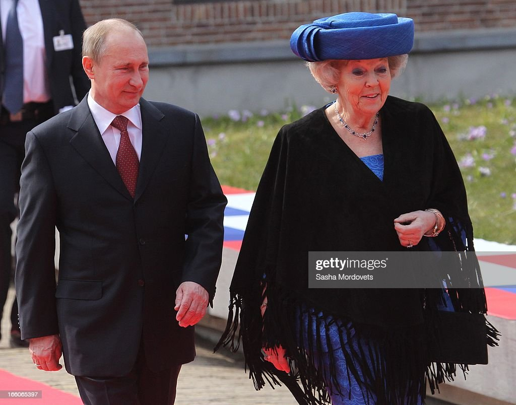 Dutch Queen Beatrix of the Netherlands (R) walks with Russian President Vladimir Putin as they attend Tsar Peter Exhibition April 8, 2012 in Amsterdam, Netherlands. Putin began a one-day state visit to the Netherlands at the invitation of Queen Beatrix.