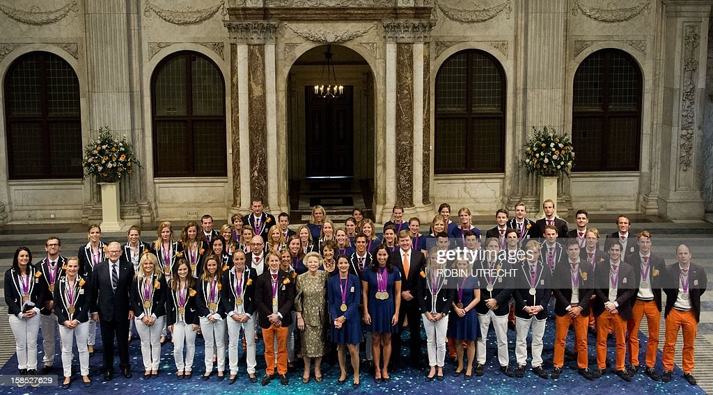 Dutch Queen Beatrix poses with the Dutch athletes of the Olympics and Paralympics 2012 in the Dam Palace in Amsterdam, The Netherlands, on December 12, 2012. The Queen invited the athletes for a lunch. netherlands out