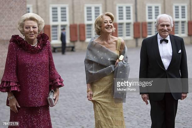 Dutch Queen Beatrix poses with the parents of Princess Maxima, Maria Carmen Cerruti and Jorge de Zorreguieta, as they arrive to attend celebrations...