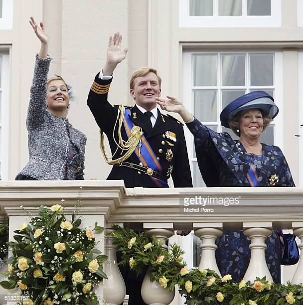 Dutch Queen Beatrix Princess Maxima and Crown Prince Willem Alexander wave from the balcony of the Noordeinde Palace during the traditional ceremony...