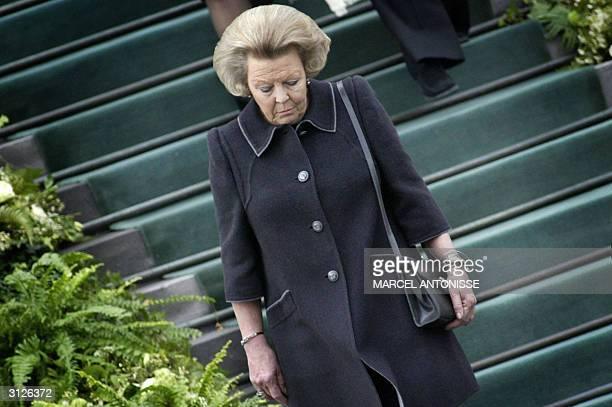 Dutch Queen Beatrix walks down the steps of Soestdijk Palace 25 March 2004 Princess Juliana who was Queen of the Netherlands from 1948 till 1980 died...