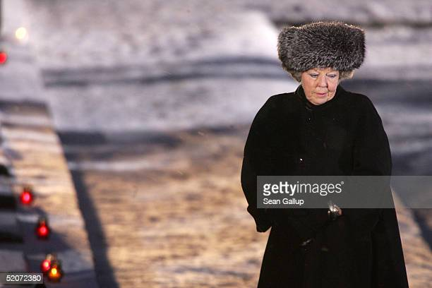 Dutch Queen Beatrix walks past the main memorial during ceremonies marking the 60th anniversary of the liberation of the Auschwitz concentration...