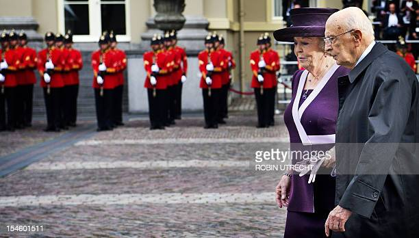 Dutch Queen Beatrix walks with Italian President Giorgio Napolitano past honor guards at the Noordeinde Palace in The Hague on October 23 2012...