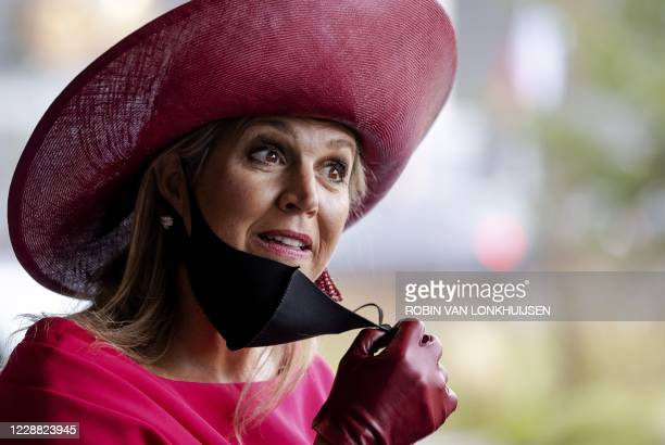 Dutch Queen Maxima adjusts her face mask after the opening of the annual breast cancer month during a meeting on the occasion of the 40th anniversary...