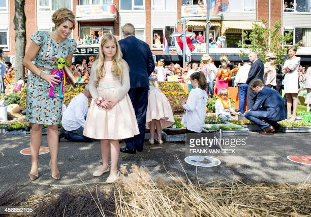 Dutch Queen Maxima and her daughter Princess Amalia look at a gardening stand in Amstelveen The Netherlands on April 26 during the first King's Day...