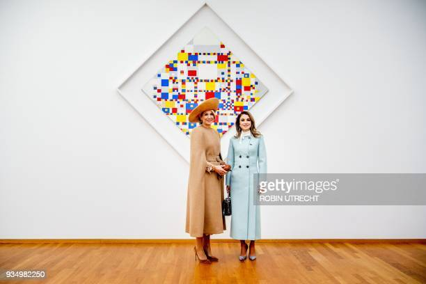 Dutch Queen Maxima and Queen Rania of Jordan pose in front of the work of art 'Victory Boogie Woogie' by Dutch artist Piet Mondrian at the...