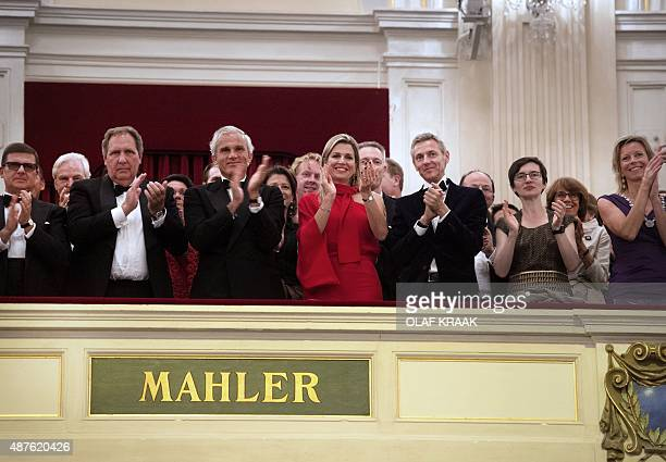 Dutch Queen Maxima applauds during the grand opening of the new Royal Concertgebouw Orchestra season at the Concertgebouw concert hall in Amsterdam...