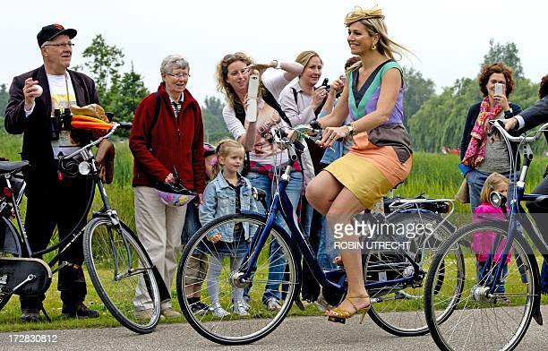 Dutch Queen Maxima arrives on a bicycle in the neighborhood Leidsche Rijn in Utrecht on July 5, 2013 for the opening of a park with her own name, the...