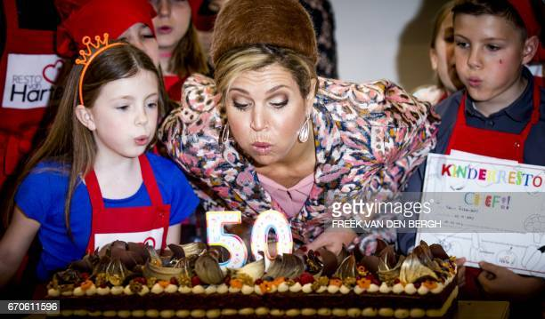 Dutch Queen Maxima attents the opening of the fiftieth Resto VanHarte in Lelystad on April 20 where children can come together to cook and learn...