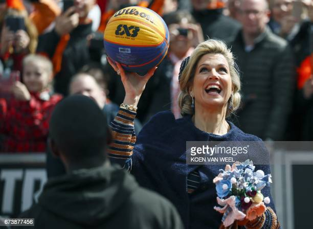 Dutch Queen Maxima holds a ball during King's Day or Koningsdag celebrations in Tilburg on April 27, 2017. Dutch King Willem Alexander is celebrating...