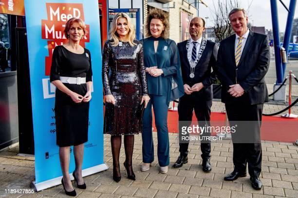 Dutch Queen Maxima , honorary chairwoman of Meer Muziek in de Klas , poses with chairwoman Carolien Gehrels , mayor of Zwolle Peter Snijders and...