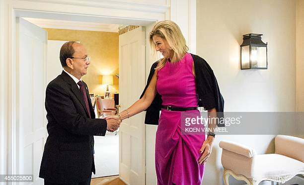 Dutch Queen Maxima shakes hands with Myanmar President Thein Sein on September 9 2014 at the Eikenhorst royal residence in Wassenaar before her...