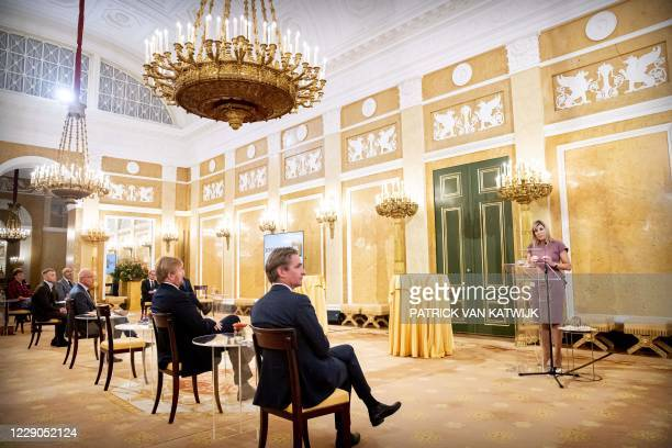 Dutch Queen Maxima speaks as she receives a small group involved in the pact Towards a debt-free Netherlands at Noordeinde Palace in The Hague on...