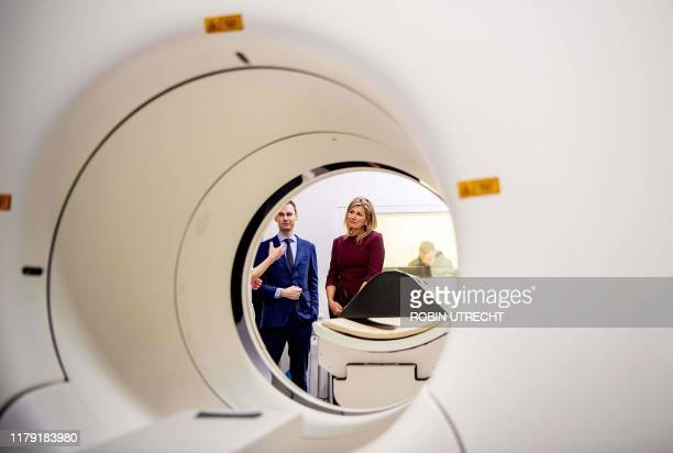 Dutch Queen Maxima takes part in a guided tour of the Translational Brain Laboratory in the Amsterdam UMC in Amsterdam on October 31 2019 /...