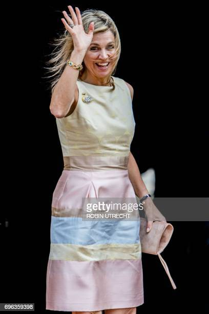 Dutch Queen Maxima waves as she arrive for a palace symposium at the Royal Palace on Dam Square in Amsterdam on June 15 2017 to speak about...