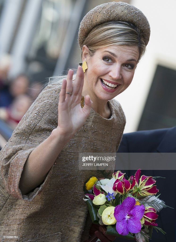 Dutch Queen Maxima waves as she arrives for the thirtieth award ceremony of the Geuzen Medal at the Grote Kerk (Big Church) in Vlaardingen, where Italian-born Regina Catrambone, co-founder of the Migrant Offshore Aid Station (MOAS), was awarded with the thirtieth Geuzen Medal at the Grote Kerk (Big Church) in Vlaardingen, on March 14, 2016. Since 1987 the Geuzen Medal Foundation (Stichting Geuzenpenning) awards the medal annually as a tribute to individuals or institutions that have, in some special way, devoted themselves to fighting for democracy or against dictatorship, discrimination and racism. / AFP / ANP / Jerry Lampen / Netherlands OUT