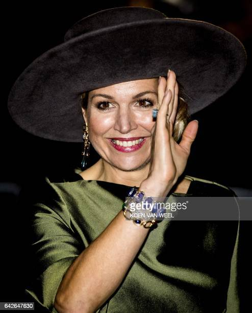Dutch Queen Maxima waves as she attends the opening of the exhibition Een Koninklijk Paradijs at The Augustijnen Church in Dordrecht on February 18...