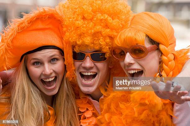 dutch queensday orange folklore mayhem - king's day netherlands stock pictures, royalty-free photos & images
